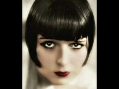 Louise Brooks raven hair, red lips, and stars in her eyes