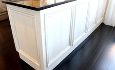 Add molding to the back of a boring kitchen peninsula to give it a little texture and more of a custom look.