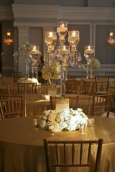 Some of the centerpieces will be crystal candelabras surrounded at the base by white hydrangeas, gold seeded eucalyptus, gray dusty miller, and blush roses and silver mercury glass votives.