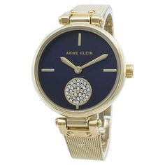 Features:  Gold Tone Stainless Steel Case Gold Tone Stainless Steel Bracelet Quartz Movement Mineral Crystal Navy Blue Analog Display Diamond Accents Pull/Push Crown Solid Case Back Jewelry Clasp 30M Water Resistance  Approximate Case Diameter: 34mm Approximate Case Thickness: 9mm Back Jewelry, Jewelry Clasps, Stainless Steel Bracelet, Stainless Steel Case, Anne Klein Watch, Michael Kors Watch, Gold Watch, Bracelet Watch, Watches For Men