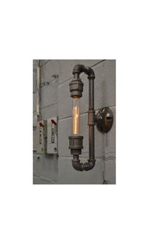 DESCRIPTION: This industrial light is flexible enough to work in a home, retail space, or office. It has a clean industrial look that is super cool and super versatile. ITEM DETAILS: -Dimensions:16 H (top of light to bottom of light) x 7 W (wall to end of light) -Foot Base on wall :
