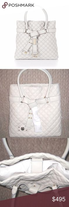 """NWT Marc Jacobs Casey Handbag Tote, Ivory White NWT Marc Jacobs Casey Handbag Tote, Ivory White  Brand new leather quilted Marc Jacobs Casey in white ivory with tags, small silver mark on the inside.  Original Retail Price of $1295. - Soft quilted leather with stitching and silver hardware - Buckled self-tie strap with Marc Jacobs plaque  - Top magnetic snap closure - Interior zip and cell phone pockets - Dimensions: 15"""" x 14"""" x 5"""" - Dust bag included  I only accept PayPal.  Item will ship…"""
