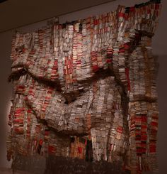 El Anatsui    Ghana.    These tapestries are made with found aluminum and copper wire.