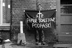 Young man holding a banner 'R.I.P. Toilet Paper and Sanitary Pads,' Wrocław, October 1987, photo: M. Michalak