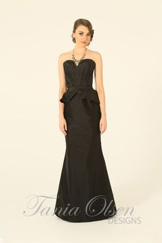 Feel confident inthe black peplum evening dress designed by Tania Olsen. Have that special go-to classic black gown in your closet, perfect for any event.