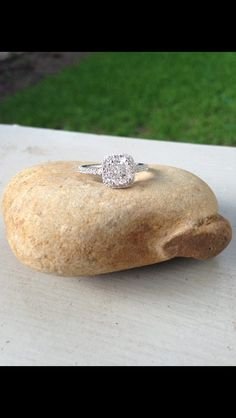 My engagement ring! Cushion cut with halo and diamonds on band.