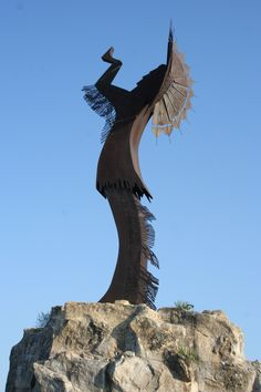 The Keeper of the Plains stands near the Big and Little Arkansas rivers in Wichita, Kansas. Photo by Neil Croxton