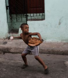 Street baseball in Santiago de Cuba. Photo by Andrea Bruce for The New York Times