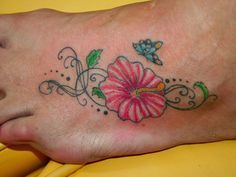 Small Butterfly And Hibiscus Tattoo On Foot