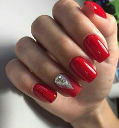 Red nails and an accent matte red nail with large rhinestones