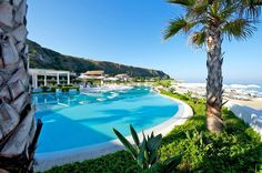 The Hotel Capovaticano Resort Thalasso is on the beaches of Calabria, Italy and has views of the Stromboli volcano