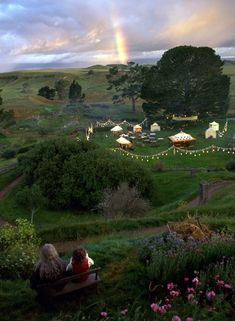 Gandalf and Frodo Baggins look out over Hobbiton in Lord of the Rings