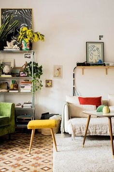ultra cool eclectic boho living room | vintage midcentury light pendant | patterned tiled floor | modular sectional sofa with bright cushions | high ceilings with mouldings | Get the look with an IKEA Söderhamn corner sofa with a Bemz cover