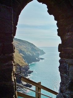 Spectacular view of the rugged North Cornwall coast from the entrance to Tintagel Castle, legendary place of conception of King Arthur. The castle is located in a superior defensive position which straddles high ground & precipitous cliffs on the mainland across to an island. This is taken from the island entrance to the castle reached by a steep narrow stone steps. Click on photo to see larger sizes & different formats available.  Photo by & copyright Richard Brookes