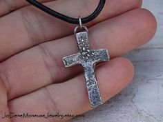 Rustic cross necklace in sterling silver on black leather $50. by JoDeneMoneuseJewelry