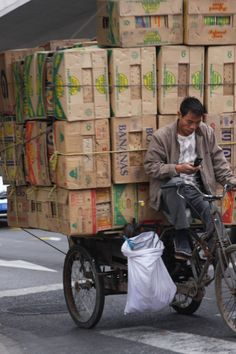 Shanghai China, delivery cyclist waiting for instructions...