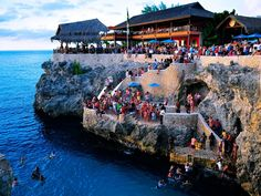 In Negril, you can have a drink at Rick's Cafe, which opened in 1774 and is perched on the side of a cliff.