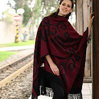 NOVICA Reversible alpaca blend ruana cloak, 'Cherry Blossom' by NOVICA. $93.99. This ruana cloak highlights Isidoro C'cahuantico's expertise in Andean fashions. It is knit of warm alpaca wool blend in dark cherry red and black featuring florid symmetrical patterns that can be appreciated on either side.