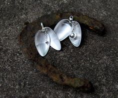 """Finnish """"bola"""" pendant like a seashell, old spoons from new silver, other parts sterlingsilver"""