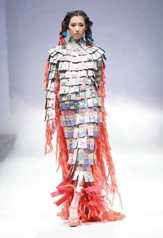 Now I know what to do with all our Pokemon playing cards!  -  12 Outrageous Looks From China Fashion Week