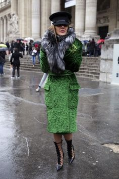 The 25 Best Street Style Snaps from Paris Fashion Week: We couldn't stay away! Here's ADR again, this time looking amazing in a green coat--though her fur looks to be getting a little soggy.