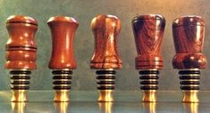 woodturnings on brass bottle stoppers Wine Bottle Stoppers, Wine Bottle Holders, Bottle Openers, Wood Router, Wood Lathe, Cnc Router, Wood Turning Projects, Wood Projects, Woodworking Jigs