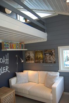 Grey painted wood paneled walls with painted wood paneled ceiling. I love this!