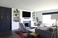 built in pantry + shelves around fireplace