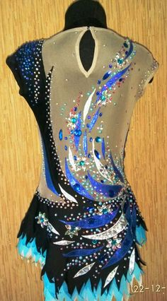 Pavone - leotard for rhythmic gymnastics This model leotards It is proposed to us for individual tailoring according to your size. Estimated production time 7-21 days. In the production used : 1. Hand-painted on fabric . 2. stones ( crystals ) DMC AB and sewing acrylic fragmentary . 3. supplex and net - production of Korea . The product is in the territory of Ukraine. We accept orders for sewing swimwear according to your design and size .