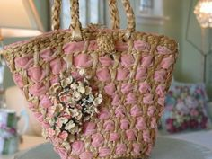 sweet little basket weave purse of pink velvet ribbon and accented with millinery flowers