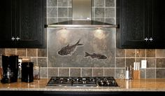 Perfecto backsplash - real fossilized fish in this stone - from Green River company.  Would kill to have this in my kitchen.
