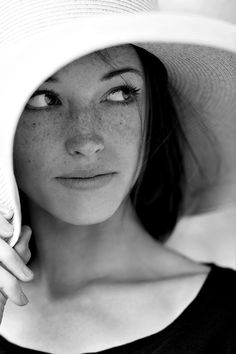 She was the type that would hide in the shade of her hat... Unlike the rest that would burn in the sun. :) careful. Reserved.