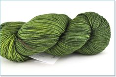 """Cashmere blend, more expensive. """"Antler"""" is the color name that is light/white. Would need 5+ skeins depending on pattern & size."""