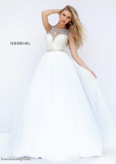 Sherri Hill 50562 is a long sleeveless ball gown with a beaded back and a sweetheart neckline.
