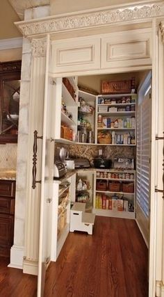 counter inside pantry to store appliances Shelves above heater in back room for appliance storage!? Perfection da?