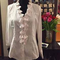 NWOT crisp white blouse A fun twist on a staple, this never-before-worn blouse makes your work outfit just a little more interesting. The collar detail is flattering and the cut is structured. A size medium, this does run on the small side. Express Tops Button Down Shirts