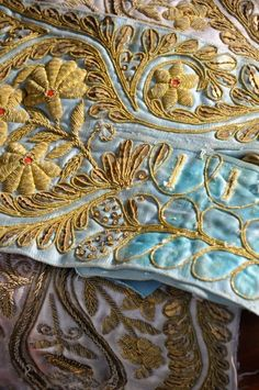 Luxe embroidery.  I am in love with the gold work.   Makes it looks super rich.