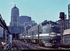 One of the most famous trains in the USA during its heyday, New York Central Train 26, The Twentieth Century Limited, behind two E8As and an E7B prepares to depart LaSalle Street Station Chicago on Aug. 10, 1964. But by then the train was no longer all-Pullman as it included sleeper-coaches in its consist.  NYC 4075 New York Central EMD E8(A) at Chicago, Illinois by Steve Patterson