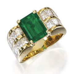 18 KARAT GOLD, EMERALD AND DIAMOND RING. Centered by an emerald-cut emerald weighing approximately 3.25 carats, flanked by rows of radiant-cut diamonds weighing approximately 1.85 carats, size 6¼.