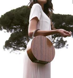 Wood, vintage, picture aesthetic and color. Unique purse style. Laurie Loo loves unique