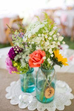 Springy floral centerpieces in mason jars {Photo by Sharon Elizabeth Photography and Freshly Wed via Project Wedding}