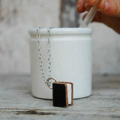 the perfect gift for a book lover... Book Necklace: Small Black Leather on Silver Chain from Peg and Awl