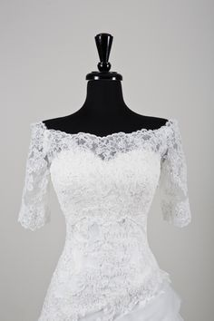 Sweetheart Gowns wedding accessories style A072 Beaded Alencon lace off the shoulder jacket with three quarter length sleeves.