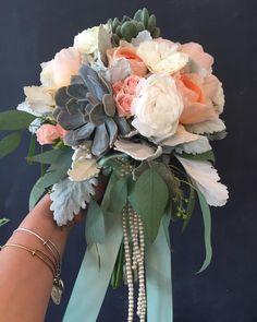 White and peach bridal bouquet! Look at those pearls! #succulent #ranunculas #julietgardenrose #whiteandpeachwedding #pearls #utahflorist #utahweddings