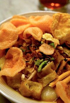 Bubur ayam: Cooked in chicken broth and served with condiments like shredded chicken, crispy fried shallot slices and ch...