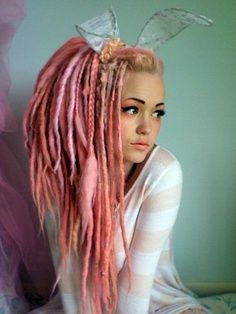 Besides the pink (and bunny ears) this is gonna be what my dreads look like (length wise) when they grow out. :) since they started with an asymmetrical cut:) excited. This girl is cute:3