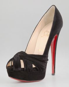 Overlapping suede straps across the toe add interest and texture to a classic suede pump. By Christian Louboutin.