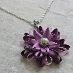 Love purple? Youll love this purple flower necklace, handmade from purple satin and organza ribbons. The necklace is shown with a 16 inch chain,