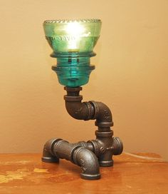 Small Industrial Style Pipe Lamp with Green Insulator. $90.00, via Etsy.