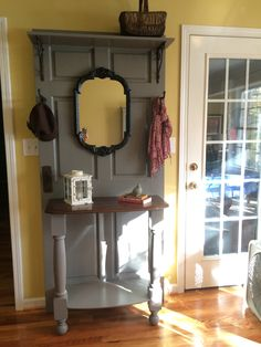 Hall Tree made from old door, headboard from bed, and two posts.